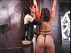 Gay girls in leather do clamping of titts